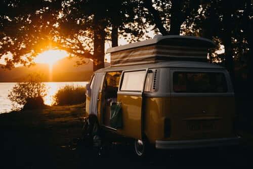 The sun setting on a retro caravan